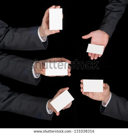 Hands hold business cards collage on black - stock photo