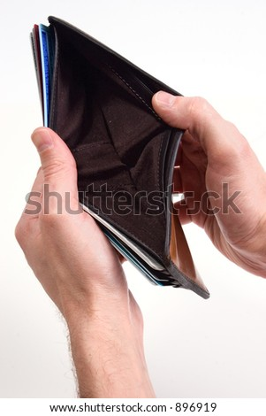 hands hold out an empty wallet - stock photo
