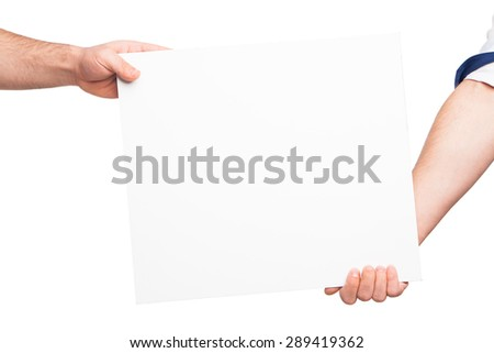Hands holding a blank white board - stock photo