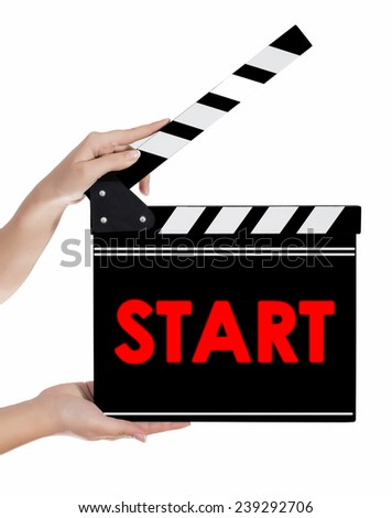 Hands holding a clapper board with START text - stock photo