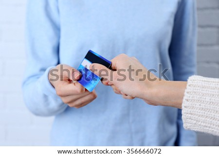 Hands holding a credit card