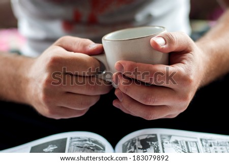 hands holding a cup of coffee - stock photo
