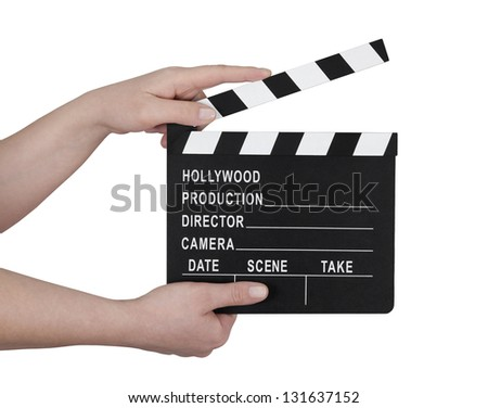 Hands holding a film clapperboard with clipping path - stock photo