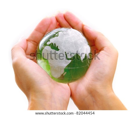 Hands holding a green earth - stock photo