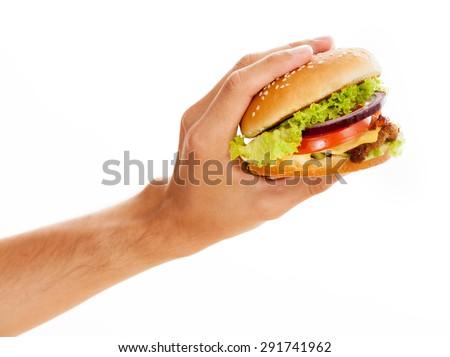 Hands holding a hamburger, isolated on white background - stock photo