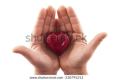 Hands holding a heart on white background - stock photo