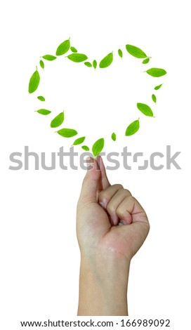 hands holding a heart shaped green leafs - stock photo