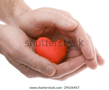 Hands holding a heart, shot on white background - stock photo