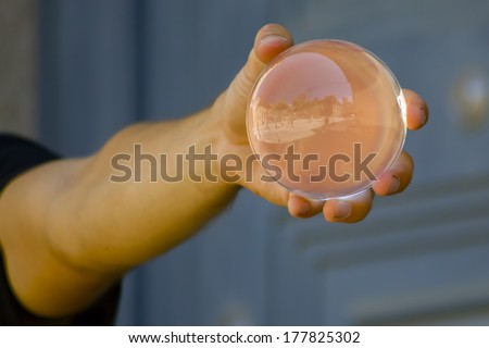 hands holding a magic crystal ball - stock photo