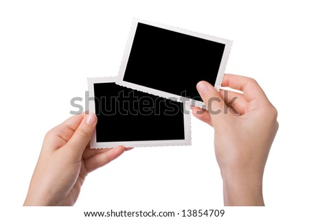 Hands holding a photograph isolated on a white background