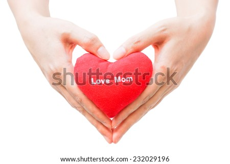 hands holding a red heart  - stock photo