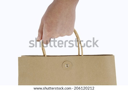 Hands holding a shopping bag - stock photo