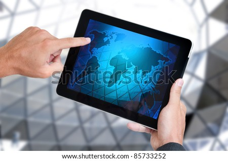 Hands holding a tablet or a Pad - stock photo