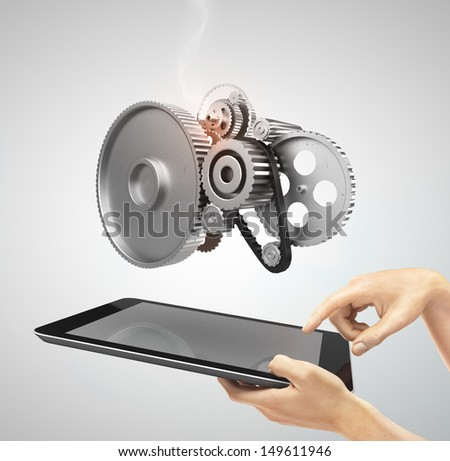 hands holding a tap with metal gears and cogs wheels - stock photo