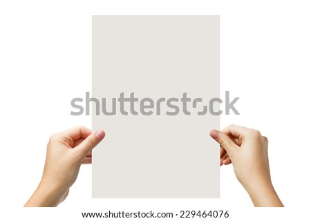 Hands holding a white paper blank isolated on white background  - stock photo