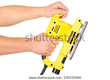 hands holding an electrical sander isolated on white - stock photo