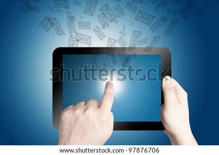 Hands holding and point on digital tablet with 3D mail icon coming from the screen on blue background - stock photo