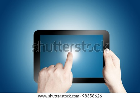 Hands holding and point on digital tablet won blue background - stock photo