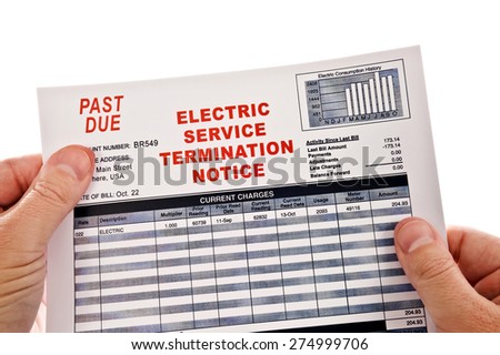 Hands Holding At Angle Electricity Cut Off Notice On White Background - stock photo