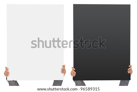 Hands holding big blank white and black Vertical paper over head - stock photo