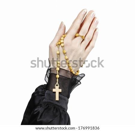 Hands holding black rosary isolated on white background. - stock photo
