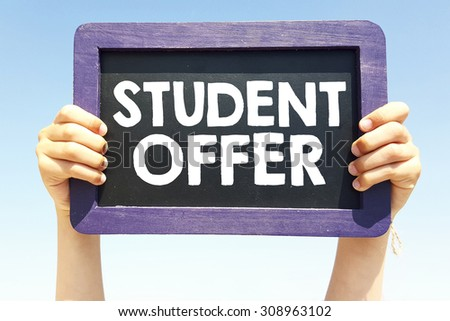 Hands holding blackboard with handwritten  student offer - stock photo
