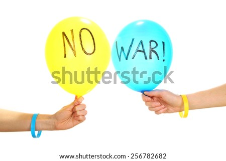 Hands holding blue and yellow balloons - no war concept - stock photo