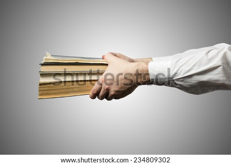 Hands holding books - stock photo