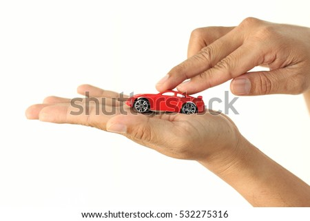 hands holding car model present vehicle and live insurance.