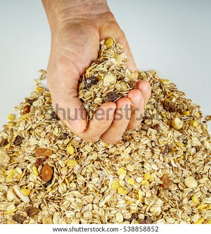 Hands holding cereals, fruits and grains