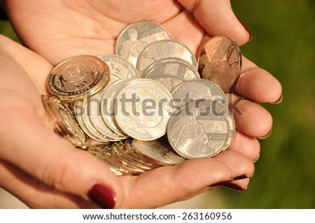 Hands holding coins - stock photo