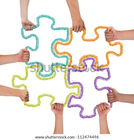 Hands holding colorful puzzle pieces - stock photo