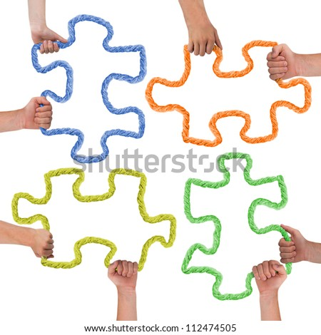 Hands holding colorful puzzle pieces