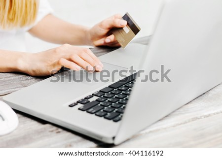 Hands holding credit card and using laptop. Online shopping concept
