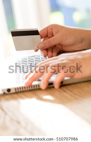 Hands holding credit card using laptop makes online payment