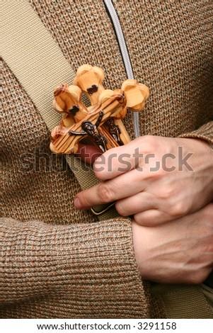 hands holding cross - stock photo