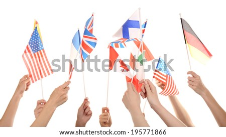Hands holding different flags, isolated on white