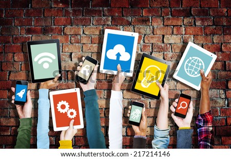 Hands Holding Digital Devices with Various Symbols - stock photo