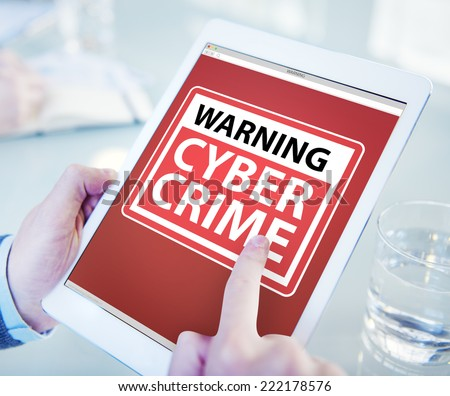 Hands Holding Digital Tablet Cyber Crime - stock photo
