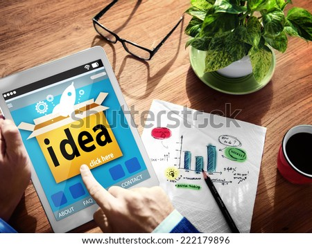 Hands Holding Digital Tablet Launching Idea - stock photo