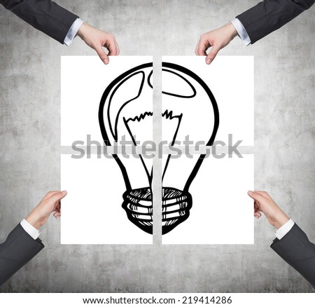 Hands holding four placards. A concept of brainstorm activity. - stock photo