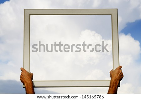 Hands holding frame. - stock photo