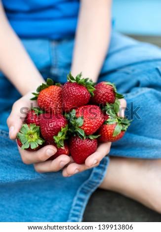 Hands Holding Fresh Strawberries - stock photo