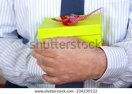 Hands holding gift - stock photo