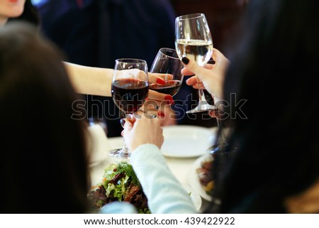 hands holding glasses and toasting, happy festive moment, luxury celebration concept - stock photo