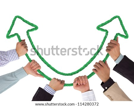 Hands holding green arrows pointing upwards - stock photo