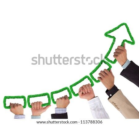 Hands holding green rope forming arrow pointing upwards - stock photo