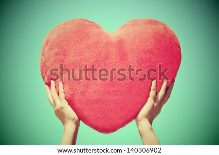hands holding heart shape with blue sky background - stock photo