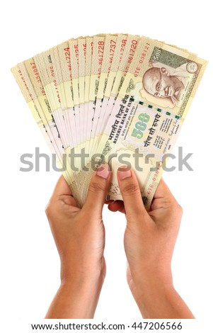 Hands holding Indian five hundred rupee notes