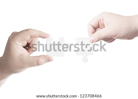 Hands holding jigsaw piece. Business concept for completion for business success - stock photo
